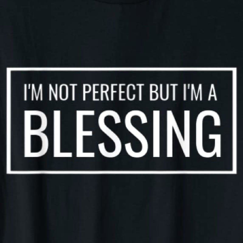 I'm Not Perfect But I'm a Blessing tee available on Amazon. Shown in black with white lettering. Available in multiple colors.