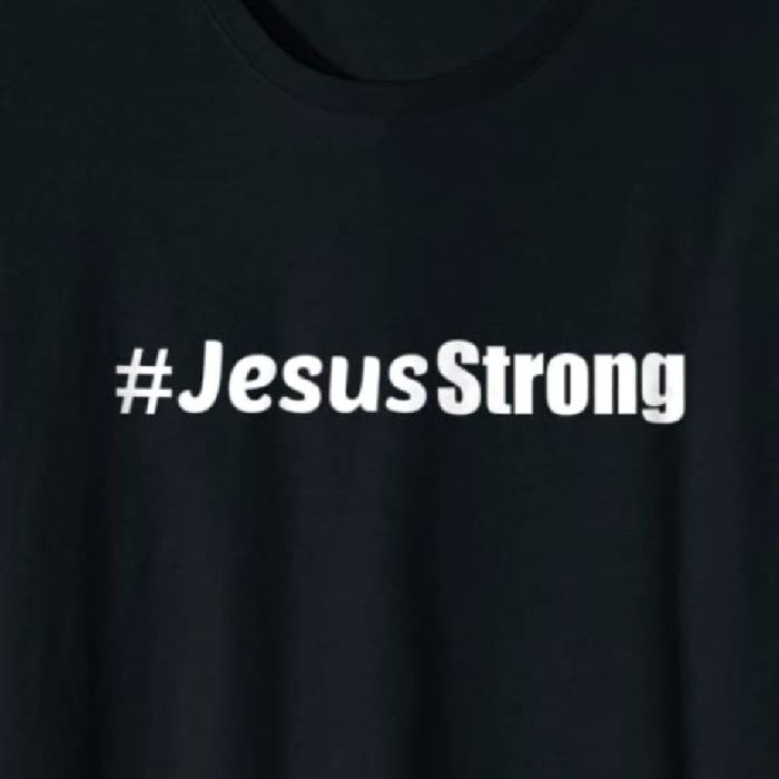 #JesusStrong tee available on Amazon. Shown in black with white lettering. Available in multiple colors.