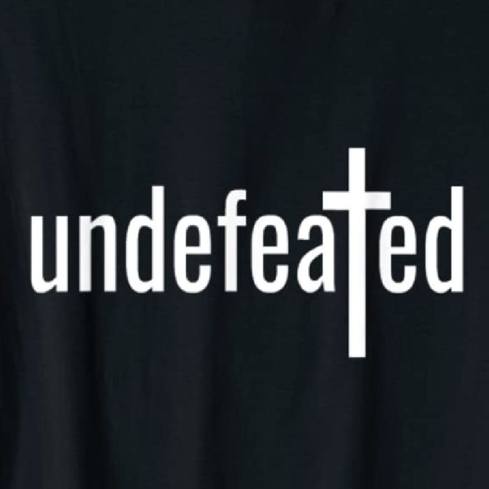Undefeated tee available on Amazon. Shown in black with white lettering. Available in multiple colors.